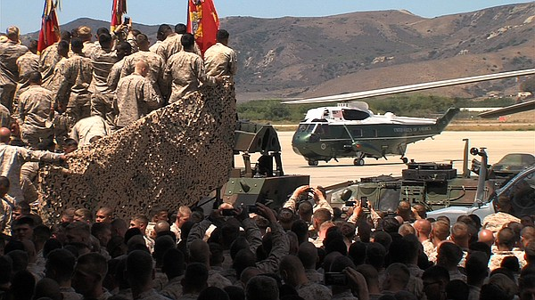 Marines look on as President Barack Obama's helicopter, M...