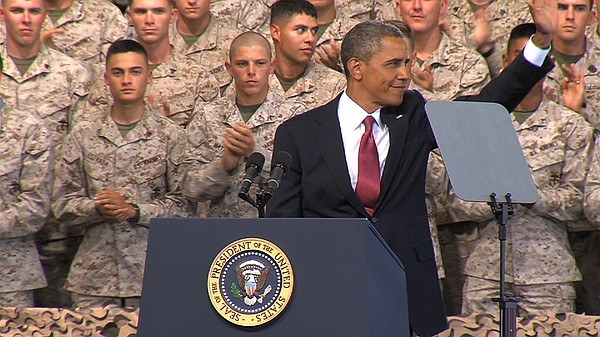 President Barack Obama waves to the troops and their familes after his speech...