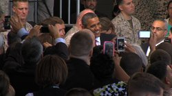 President Barack Obama poses for a picture with a Marine after his speech at ...