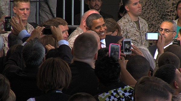 President Barack Obama poses for a picture with a Marine ...