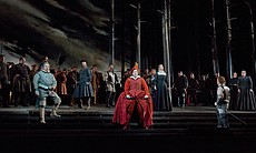 "A scene from Donizetti's ""Maria Stuarda"" with Matthew Polenzani as Leicester, Joshua Hopkins as Cecil, Elza van den Heever as Elisabetta, and Joyce DiDonato as Maria Stuarda."