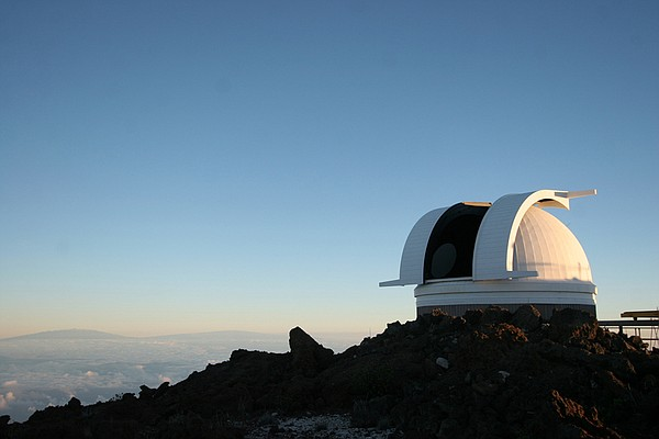 Observatories prepare for a night of research on Haleakala, Hawaii.