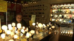 Lighting store owner Larry Birnbaum shows off his collection of antique and m...