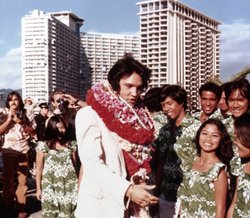 Elvis and fans, Hawaii. Elvis Presley made television history in 1973 with a live concert special, televised globally via satellite.