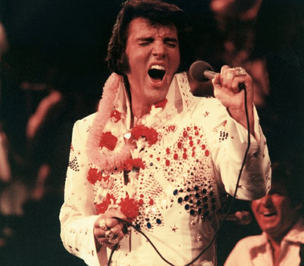 Elvis Presley, pictured performing live, made television ...