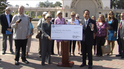 City Council President Todd Gloria and Jason Quinn (far left) of the Balboa Park Online Collaborative pose with a $15,000 check for expanded wireless Internet services in Balboa Park, Aug. 15, 2013.