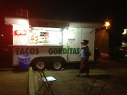 The Datapoint Taqueria lights up a parking lot in San Antonio.