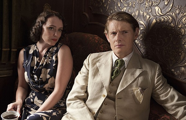 Keeley Hawes as Laura Parmiter and Julian Rhind-Tutt as M...