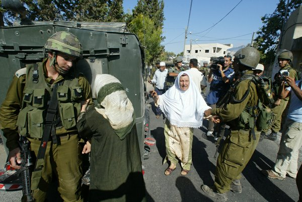 Emad's mother pleads with an Israeli soldier to release h...