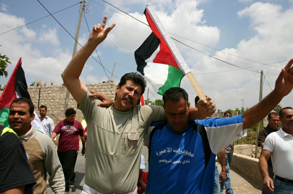 Adeeb and Phil participate in a protest against the Israe...