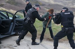 DCI Gill Murray (Amelia Bullmore) is surrounded by police after her abduction.