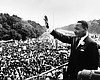 Martin Luther King Jr. is shown waving to atten...