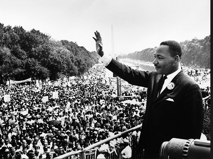 Martin Luther King Jr. is shown waving to attendees at the The March on Washi...