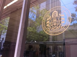 The city of San Diego seal on the city administration building.