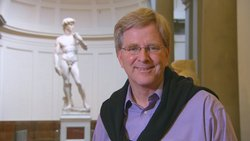 "Rick Steves at the Accademia with Michelangelo's ""David,"" Florence, Italy."