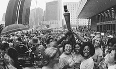 Billie Jean King, center, and other participants in the International Women's Year torch relay, hold the torch high at the end of the 2,600 mile run in Houston, Texas. The relay began in Seneca Falls, New York on September 8th and over 2,000 runners took part, each averaging about a mile.