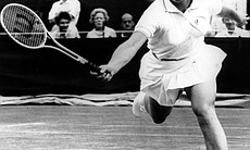 Billie Jean King returns the ball during the fourth round of the women's singles in the All England lawn tennis championships in Wimbledon, England on July 2, 1968. Her opponent is Fay Moore.