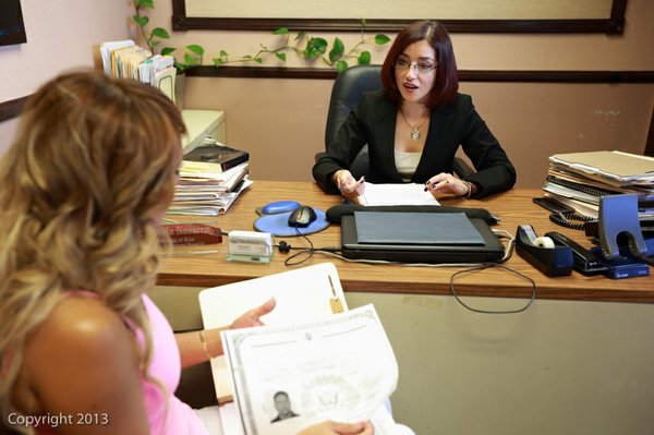 Fabiola Navarro, speaking with a client in her office.