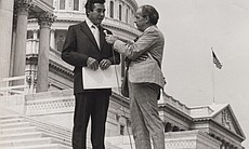Herman Badillo being interviewed on the steps of the U.S. Capitol.
