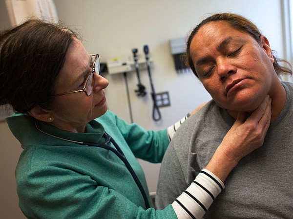 Nurse Practitioner Tina Clark examines Anastacia Casperson at the Glide Healt...