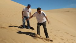 Host Jorge Meraz goes sandboarding down the sand dunes in the small town of Algodones, Baja California, Mexico.