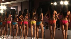 Miss India contestants line up to be judged in the swimsuit round.