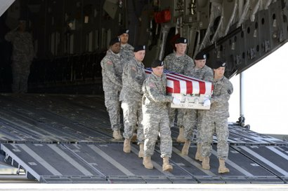 A U.S. Army carry team transfers the remains of Staff Sgt. Randall R. Lane du...