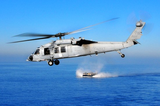 An MH-60S Knighthawk helicopter flies over the Pacific Ocean, Dec. 6, 2008