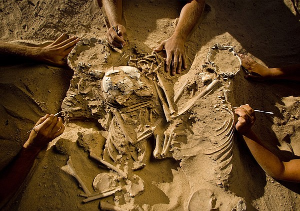Excavation of a triple burial in the Sahara Desert.