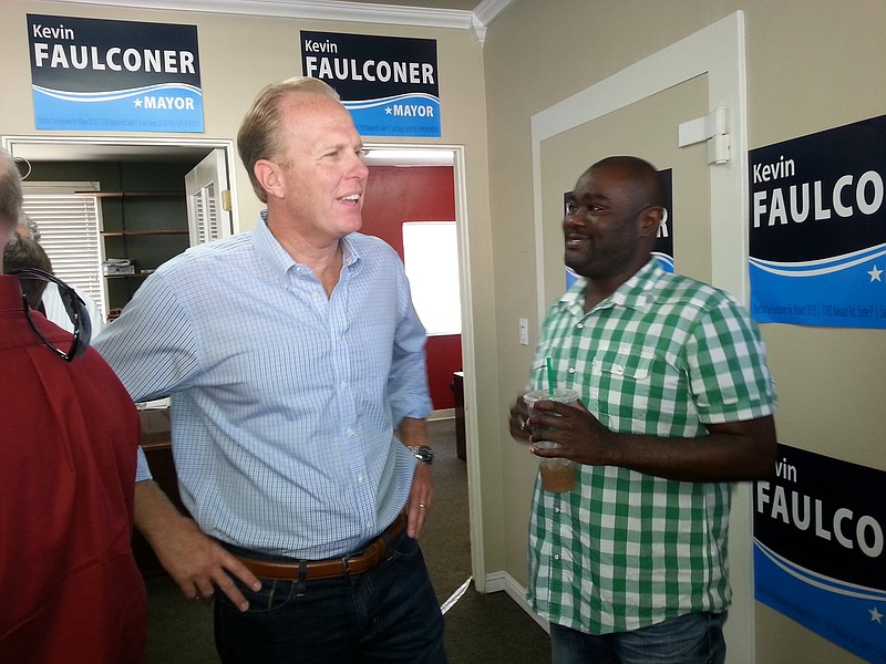 City Councilman Kevin Faulconer talks to neighborhood activist Dwayne Crensha...