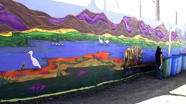 """Tijuana artist Alfredo """"Libre"""" Gutierrez recently finished a mural that adorns the entrance to Los Sauces park in Playas de Tijuana."""
