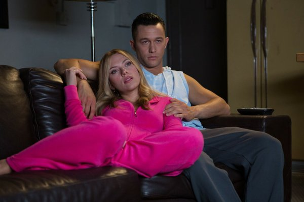 Don Jon (Joseph Gordon-Levitt) looking less than enthused alongside a very in...