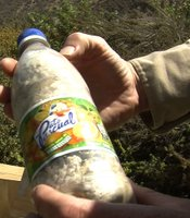 4Walls Int'l pays Tijuana residents for each plastic bottle they deliver stuffed full of plastic bags and Styrofoam.