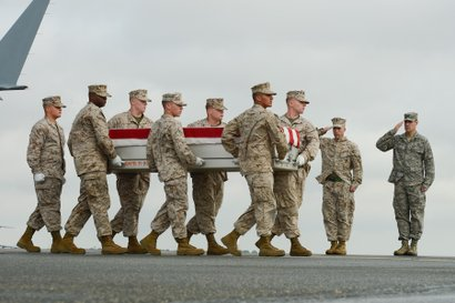 U.S. Marine Corps carry team transfers the remains of Lance Cpl. Jeremiah Collins, Jr. at Dover Air Base on October 7, 2013.