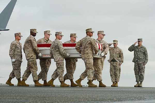 U.S. Marine Corps carry team transfers the remains of Lance Cpl. Jeremiah Col...