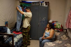 Dionicia Martinez and her husband in their room at the racetrack.