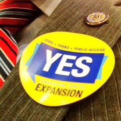 A sticker in support of the convention center expansion.