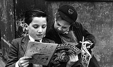 Two young boys reading comics, 1952.