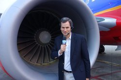David Pogue prepares for the plane boarding test.