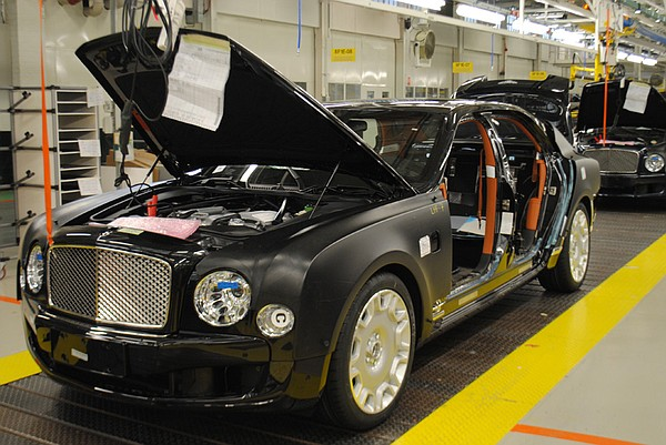 Black Bentley on assembly line.