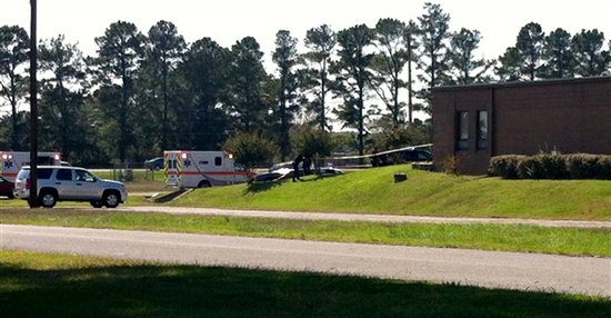 Ambulances respond to shooting at National Guard Armory near Naval Support Activity Midsouth.