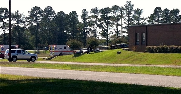 Ambulances respond to shooting at National Guard Armory near Naval Support Ac...