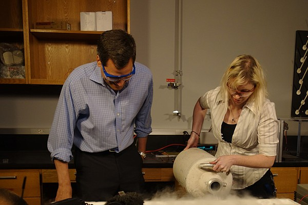 David Pogue looks on as Melissa Gooch does demonstration, University of Houston.
