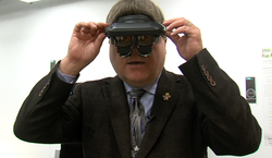 UC San Diego's Dr. Erik Viirre straps on an early augmented reality headset he helped develop at the now-defunct Seattle company Virtual i-O.