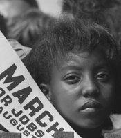 Rowland Scherman was the official government photographer for the March on Washington in 1963. He took this photo of a young girl named Edith Lee Payne. Payne did not know her photo was taken until 49 years later when she recognized herself in a photo in a civil rights themed calendar.