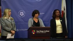 San Diego Unified Superintendent Cindy Marten (center) disclosed that two Serra High School coaches who wore blackface to a San Diego State football game as part of a Halloween costume have been disciplined at a press conference, nov. 1, 2013. She was joined by Tammy Gillies, regional director of the Anti-Defamation League (left) and Lei-Chala Wilson, president of the NCAACP San Diego Branch.