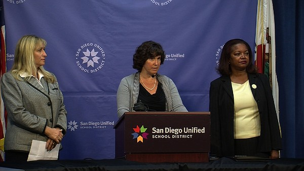 San Diego Unified Superintendent Cindy Marten (center) di...