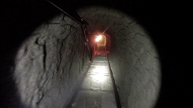 This photo released by U.S. Immigration and Customs Enforcement on Oct. 31, 2013 shows a drug-smuggling tunnel linking warehouses in Tijuana and San Diego.