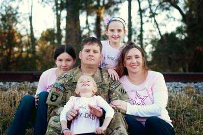 Army Sgt. 1st Class Forrest W. Robertson and family