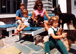 President Kennedy, John F. Kennedy Jr., Jacqueline Kennedy and Caroline Kennedy with family dogs, Hyannisport, Squaw Island, August 14, 1963.